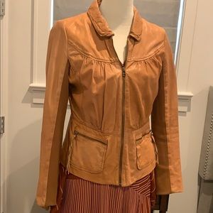 Leather jacket with fabric sleeves